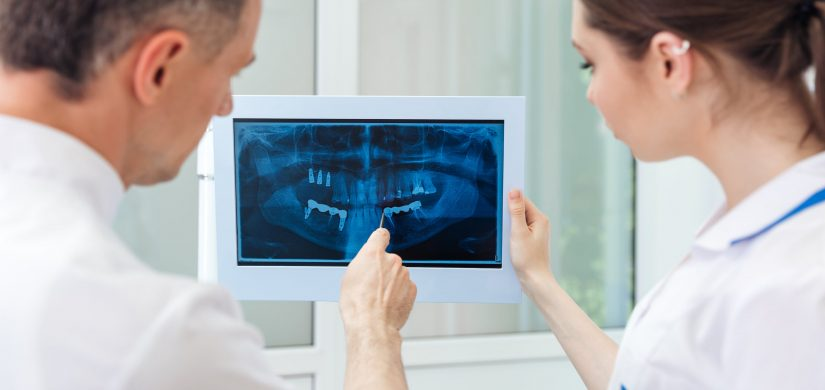 dentist showing something on the computer monitor