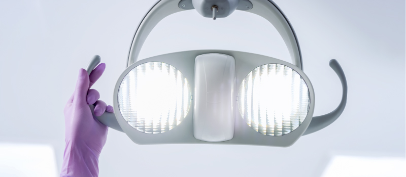 Closeup of a light over a dental chair for a post about advanced dental technology