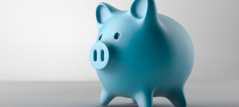 A blue piggy bank on a gray background